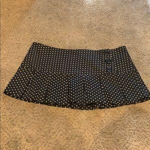 Black poka dot mini skirt